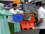 bupati-bangkalan-rk-abdul-latif-amin-imron-di-posko-peduli-korban-bencana-banjir.jpg