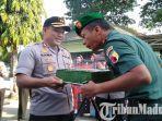 dandim-0829-bangkalan-letkol-kav-ari-setyawan-wibowo-nerima-kue-hut-74-tni-dari-kapolres-bangkalan.jpg