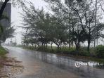 foto-cuaca-hujan-di-jalan-raya-sumenep-pamekasan.jpg
