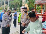 gerai-masker-gratis-yang-disediakan-oleh-polres-sumenep-di-depan-masjid-agung-sumenep.jpg
