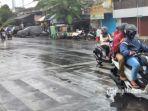 hujan-deras-mengguyur-pengendara.jpg