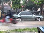 jalan-re-martaditana-kelurahan-mlajah-kecamatan-kota-bangkalan-diguyur-hujan-dengan-intesitas-sedang.jpg