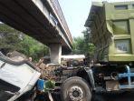 kepala-dump-truk-lepas-tersangkut-flyover-di-sidoarjo.jpg