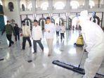 ketua-umum-dewan-masjid-indonesia-jusuf-kalla-wakil-gubernur-jatim-emil-dardak.jpg