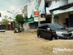 kondisi-banjir-di-jalan-imam-bonjol-kelurahan-dalpenang-kabupaten-sampang.jpg