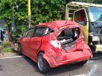 kondisi-honda-jazz-dan-truk-kendaraan-yang-terlibat-kecelakaan-di-krian-sidoarjo-rabu-962021.jpg
