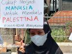 massa-aksi-yang-menggelar-aksi-indonesia-bela-palestina-di-depan-gedung-dprd-jawa-timur.jpg