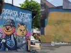 mural-viral-di-pasuruan-bertuliskan-dipaksa-sehat-di-negara-yang-sakit.jpg