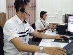 operator-pamekasan-call-care-saat-siaga-depan-monitor-di-pendopo-ronggosukowati-pamekasan.jpg