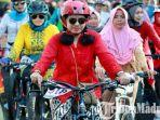 perempuan-berkebaya-mengikuti-balap-sepeda-women-cycling-challenge-di-banyuwangi.jpg