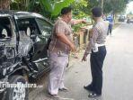 personel-satlantas-polres-pamekasan-terjadinya-kecelakaan-truk-fuso-dan-inova-di-jalan-raya-artodung.jpg