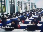 peserta-seleksi-cpns-2021-ujian-tes-skd-di-gedung-smp-negeri-1-sampang-madura-2192021.jpg