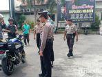 petugas-kepolisian-memeriksa-setiap-tamu.jpg