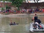 petugas-tengah-melakukan-pencarian-bocah-14-tahun-yang-dilaporkan-tenggelam-di-sungai-kalimas.jpg
