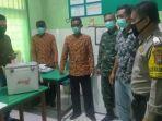 pihak-kepolisian-mengawal-pendistribusian-vaksin-covid-19-di-wilayah-kecamatan-talango.jpg
