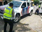 polisi-melakukan-olah-tkp-di-jalan-raya-dungus-kare-desa-wungu-kecamatan-wungu.jpg