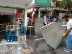polisi-memeriksa-di-lokasi-ledakan-akibat-kebocoran-gas-di-sebuah-toko.jpg