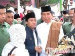 presiden-jokowi-saat-dikerubungi-warga-yang-minta-foto-bareng-di-bangkalan.jpg