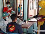 proses-pengecekan-kesehatan-pmi-asal-kabupaten-trenggalek.jpg