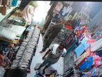 rekaman-cctv-saat-pasutri-pelaku-pencurian-beraksi-di-sebuah-toko-baju.jpg