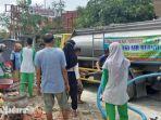 siswa-pecinta-alam-arjuna-man-1-pamekasan-dan-frpb-pamekasan-membagikan-air-bersih.jpg