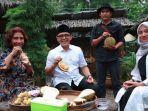 susi-pudjiastuti-saat-menikmati-durian.jpg