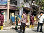 tim-relawan-rumah-karantina-kampung-tangguh-covid-19-di-perum-griya-abadi-bangkalan.jpg