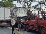 truk-box-terlibat-kecelakaan-dievakuasi-mobil-derek-satlantas-polres-nganjuk.jpg