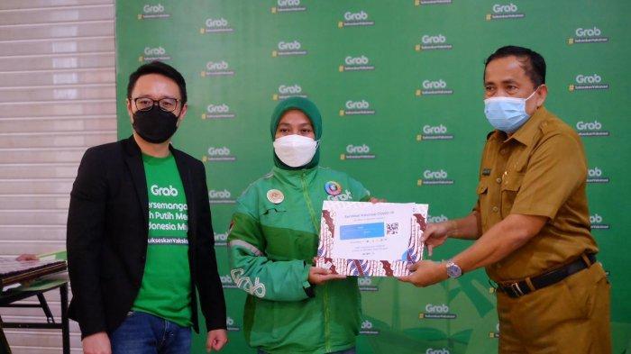 Bantuan Teknologi Grab, Dinkes dan PMKIT Vaksinasi 3.500 Masyarakat Makassar