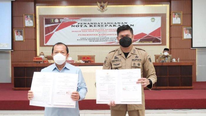FOTO: Unit Layanan Paspor di Kabupaten Gowa Beroperasi November - bupati-gowa-adnan-purichta-ichsan-teken-mou-dengan-kemenkumham-sulsel-2.jpg