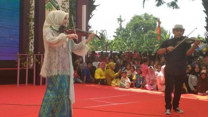 Cantiknya Putri Ichsan Yasin Limpo Main Biola di HUT Gowa