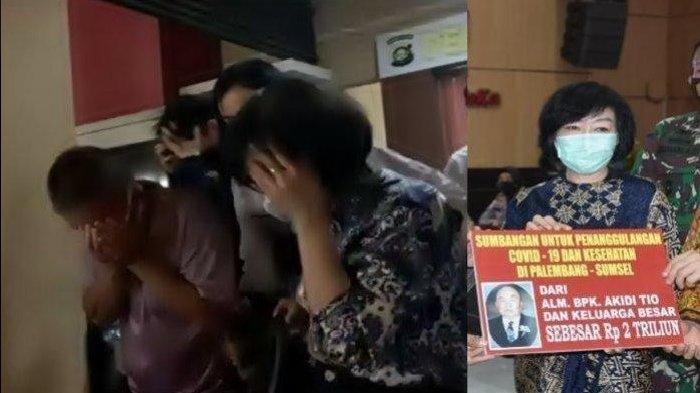 Heriyanti, suami dan anaknya nampak menutupi wajahnya setelah diperiksa di Polda Sumsel. Ketiganya dikawal petugas setelah diperiksa karena sumbangan Rp2 triliun tak kunjung cair.