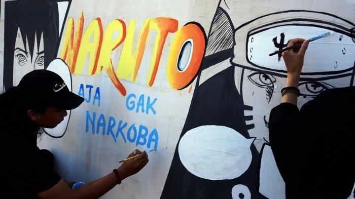 FOTO; Peringati Hari Anti Narkoba, Himasera Unismuh Gelar Aksi Mural - himasera-membuat-karya-mural-bertemakan-anti-narkoba-di-kampus-unismuh-2.jpg