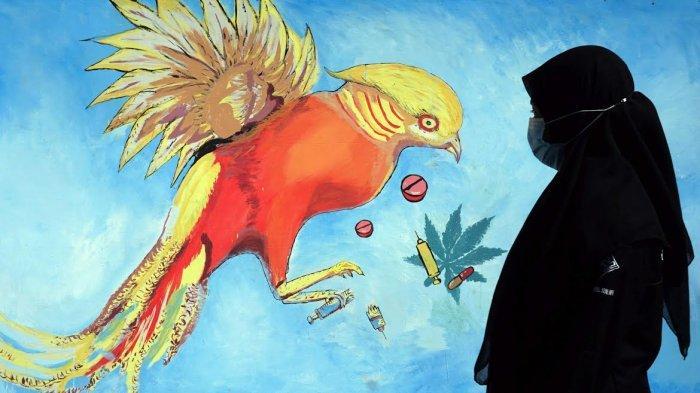 FOTO; Peringati Hari Anti Narkoba, Himasera Unismuh Gelar Aksi Mural - himasera-membuat-karya-mural-bertemakan-anti-narkoba-di-kampus-unismuh-4.jpg