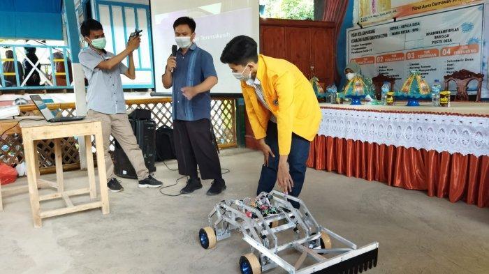 Tim PkM UNM Uji Coba Robot Pengaduk Gabah Kering di Desa Lempangeng Gowa