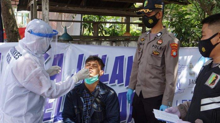 Pos Penyekatan Perbatasan Polman - Pinrang, Petugas Sediakan Rapid Test Antigen