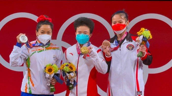 Medali pertama di Olimpiade Tokyo dari Atlet Angkat Besi, usianya masih 19 Tahun