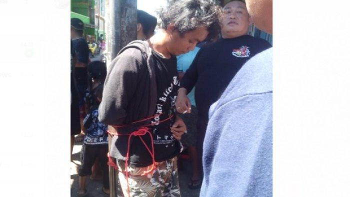 Usai Ditangkap, Pelaku Pembakaran Mimbar Masjid Raya Makassar Diikat di Tiang Telepon