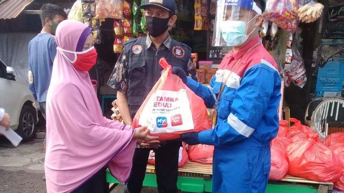Gandeng UMKM di Kota Makassar, Pertamina Salurkan 675 Paket Sembako