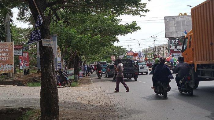 13 'Pak Ogah' di Sepanjang Jalan Perintis Kemerdekaan, Sebagian Tak Pakai Masker