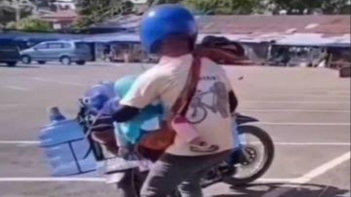 Viral Video Kisah Haru Ayah Angkut Galon Sambil Gendong Anaknya