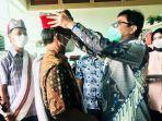 anggota-dewan-komisioner-ojk-tirta-segara-di-bandara-toraja-minggu-3102021.jpg