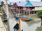 banjir-kembali-melanda-pemukiman-di-kabupaten-wajo-sulawesi-selatan-senin-1972021.jpg