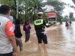 banjir-menutupi-badan-jalan-trans-sulawesi-di-larompong-kabupaten-luwu-2882921.jpg