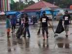 cegah-penularan-penyakit-di-musim-hujan-dani-community-maros-keren-bersihkan-pasar.jpg