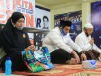 chaidir-syam-suhartina-bohari-bersama-relawan-sambut-1-muharram.jpg