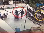 dua-pelaku-penyerang-yang-diduga-teroris-saat-tiba-di-halaman-parkir-bank-di-poso.jpg