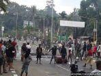 foto-agus-kossay-dalang-kerusuhan-di-jayapura-papua-ditangkap-polisi-saat-kendarai-motor-curian.jpg