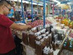 ismail-pedagang-di-pasar-rakyat-butta-salewangang-maros.jpg