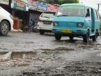jalan-berlubang-di-depan-pasar-antang-jl-antang-raya-kecamatan-manggala-kota-makassar.jpg